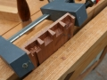 A clamp helps protect fragile half pins while refining with chisel work