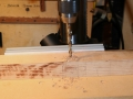 Drill holes for draw bore pegs