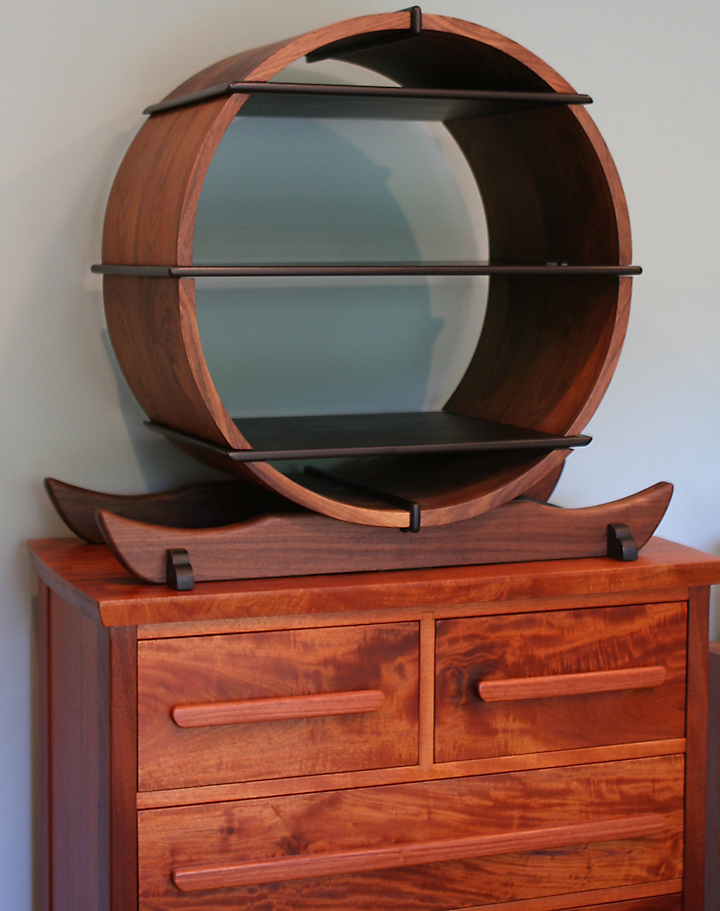 Circular Shelf on Mahogany Dresser