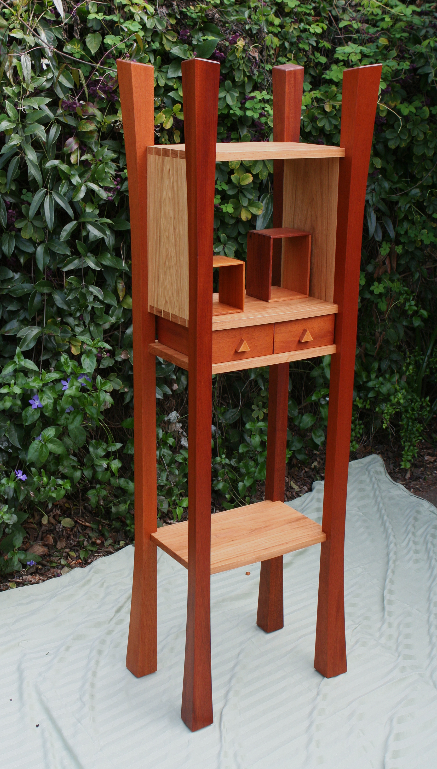 A display stand of Mahogany and Hickory