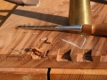 Saw boundary of dovetail sockets plus a few extra cuts to make chopping easier.