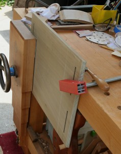 Shelf is secured to the bench and edges shaped with rasps and sandpaper.