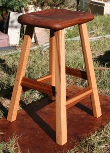 This stool was created from one two-inch thick board
